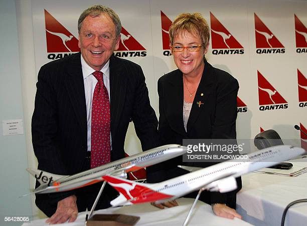 Geoff Dixon , the chief executive officer of Qantas Airways Ltd, and Qantas chairwoman Margaret Jackson display the new Boeing 787 in the designs of...