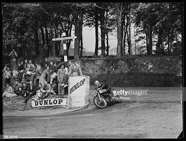 Geoff Duke passes Governor's Bridge during the Junior TT Race on the Isle of Man 5th June 1951 He won the race on his Norton motorcycle setting a new...
