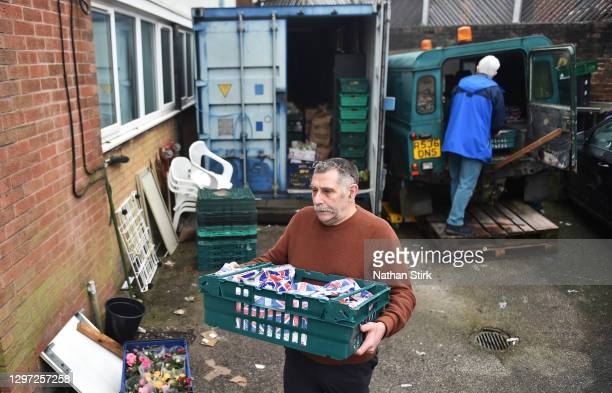 Geoff Harriman, chairman of Tri Service Support Centre collects food for the food bank on January 15, 2021 in Newcastle-under-Lyme, England. Early in...