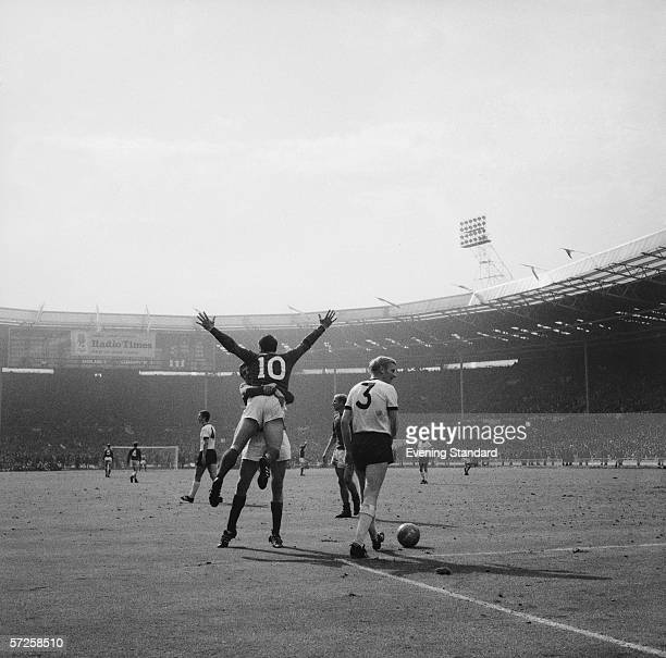 Geoff Hurst celebrates with a team mate during the 1966 World Cup Final at Wembley Stadium, 30th July 1966. The score stands at 2-2 and England won...