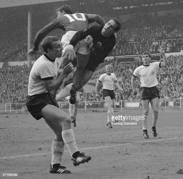 Geoff Hurst clashes with the West German goalkeeper Hans Tilkowski and a defender during the 1966 World Cup Final at Wembley Stadium 30th July 1966...