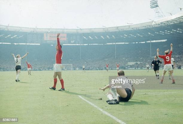 Geoff Hurst left in red celebrates scoring England's third goal against West Germany in the World Cup Final at Wembley Stadium 30th July 1966 England...