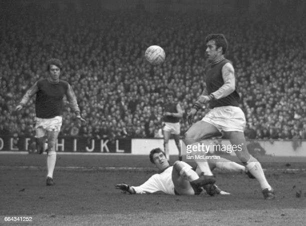 Geoff Hurst of West Ham United passes Ron Yeats of Liverpool FC in the Football League Division 1 at Upton Park London on 22nd February 1969