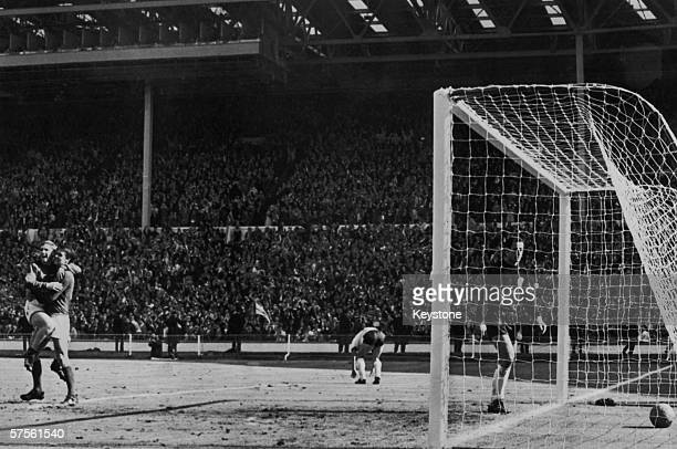 Geoff Hurst scores England's fourth goal against West Germany during the World Cup Final at Wembley Stadium 30th July 1966 England won the match 42