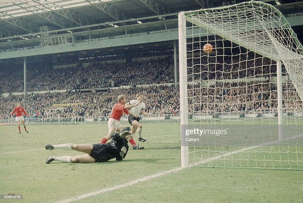 Geoff Hurst scores England's third goal against West Germany in the World Cup Final at Wembley Stadium, 30th July 1966. England went on to win the match 4-2.