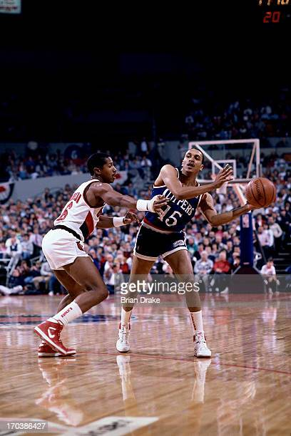 Geoff Huston of the Los Angeles Clippers passes against Mike Holton of the Portland Trail Blazers during a game played in 1986 at the Veterans...