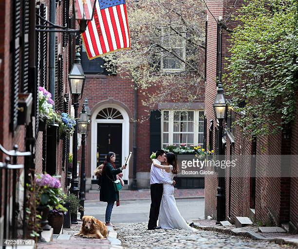 Geoff Li and Sharon Wang posed for prewedding photos taken by their friend Stacy Song as Na Zhao assisted on Acorn Street in Beacon Hill