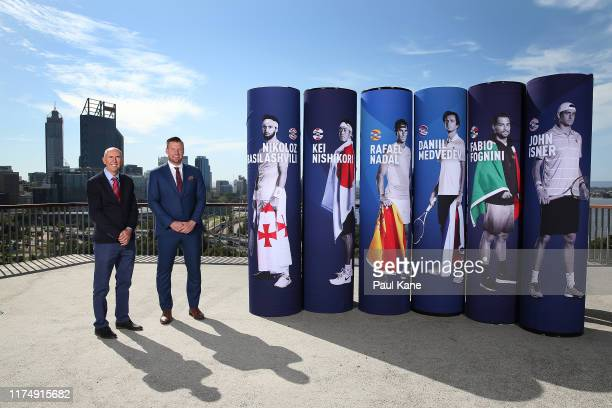 Geoff Masters and Sam Groth pose with pillars with images of representative players during the 2020 ATP Cup Draw at Fraser's Kings Park on September...