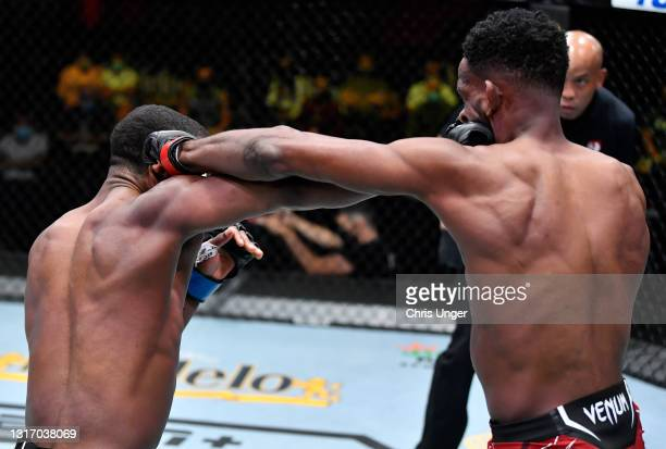 Geoff Neal and Neil Magny trade punches in a welterweight fight during the UFC Fight Night event at UFC APEX on May 08, 2021 in Las Vegas, Nevada.