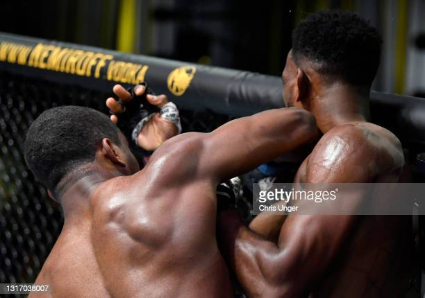 Geoff Neal elbows Neil Magny in a welterweight fight during the UFC Fight Night event at UFC APEX on May 08, 2021 in Las Vegas, Nevada.