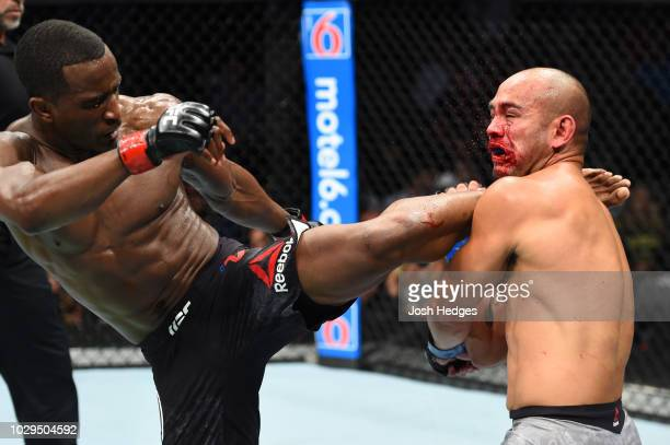 Geoff Neal kicks Frank Camacho of Guam in their welterweight fight during the UFC 228 event at American Airlines Center on September 8 2018 in Dallas...