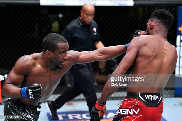 Geoff Neal punches Neil Magny in a welterweight fight during the UFC Fight Night event at UFC APEX on May 08, 2021 in Las Vegas, Nevada.