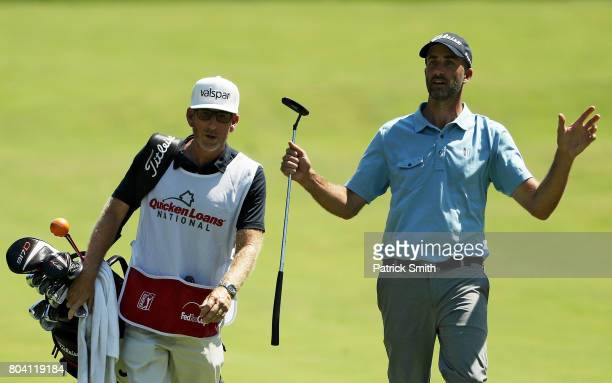 Geoff Ogilvy of Australia and his caddie walk on the fifth hole during the second round of the Quicken Loans National on June 30 2017 TPC Potomac in...