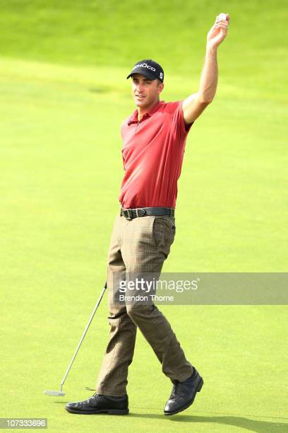 Geoff Ogilvy of Australia celebrates on the 18th hole after winning the Australian Open at The Lakes Golf Club on December 5, 2010 in Sydney,...