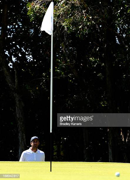 Geoff Ogilvy of Australia chips onto the green on the 16th hole during round two of the Australian PGA Championship at Palmer Coolum Resort on...
