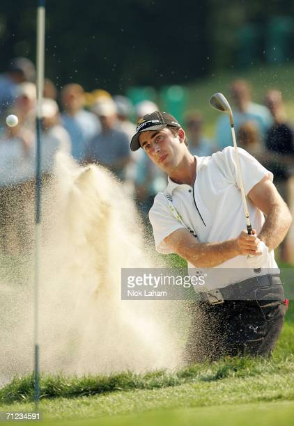 Geoff Ogilvy of Australia hits from the bunker on the 11th hole during the final round of the 2006 US Open Championship at Winged Foot Golf Club on...