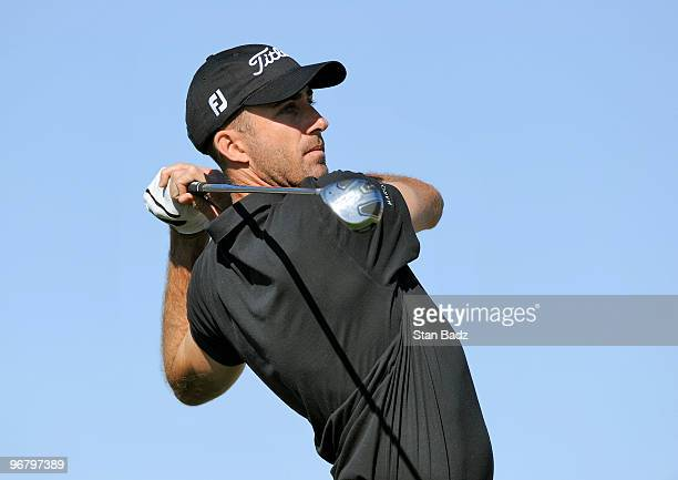 Geoff Ogilvy of Australia hits from the ninth tee box during the first round of the World Golf ChampionshipsAccenture Match Play Championship at The...