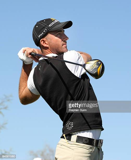 Geoff Ogilvy of Australia hits his tee shot on the ninth hole during the final round of the FBR Open on February 1 2009 at TPC Scottsdale in...