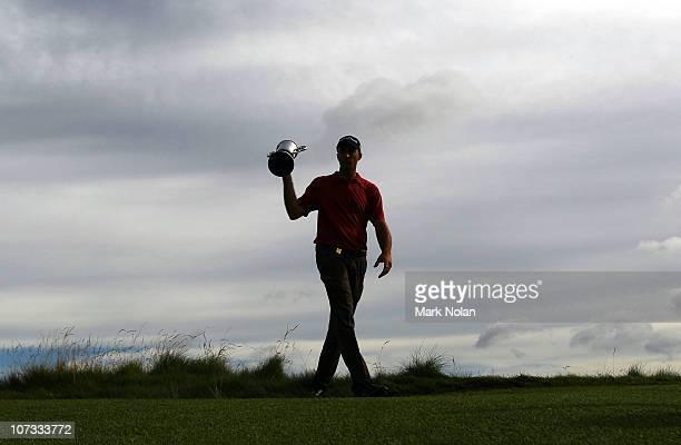 Geoff Ogilvy of Australia holds the Australian Open trophy day four of the Australian Open at The Lakes Golf Club on December 5, 2010 in Sydney,...