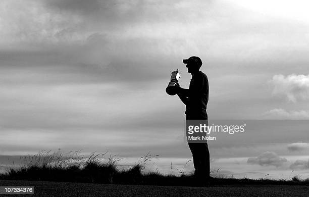 Geoff Ogilvy of Australia holds the Australian Open trophy day four of the Australian Open at The Lakes Golf Club on December 5 2010 in Sydney...