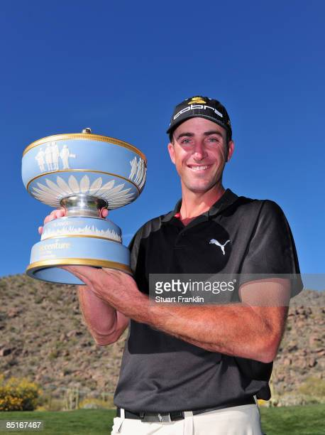 Geoff Ogilvy of Australia holds the trophy after winning his match against Paul Casey of England on the 16th hole during the final round of Accenture...