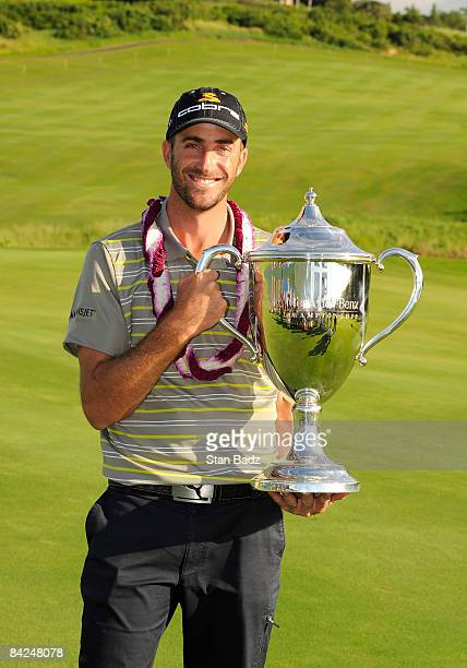Geoff Ogilvy of Australia holds the winner's trophy after the final round of the Mercedes-Benz Championship held at Plantation Course at Kapalua on...