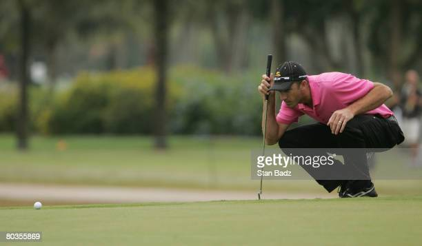 Geoff Ogilvy of Australia lines up a putt on the 11th green during the completion of the final round of the WGCCA Championship held on March 24 2008...