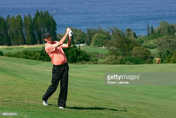 Geoff Ogilvy of Australia makes an approach shot on the 4th hole during the third round of the PGA Mercedes Championships on January 7 2006 at the...