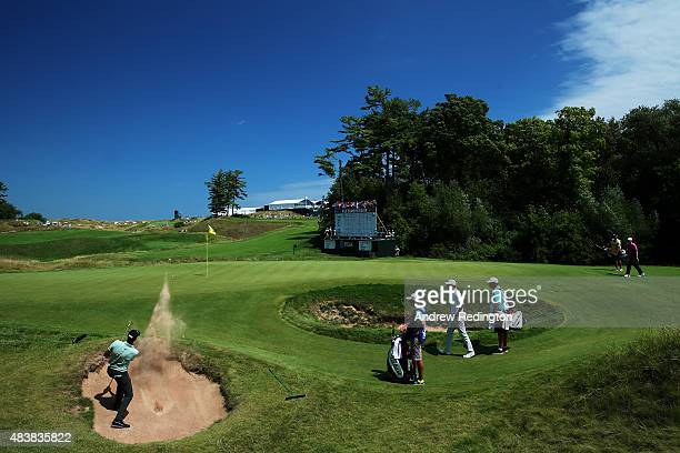 Geoff Ogilvy of Australia plays a shot from a bunker on the ninth hole during the first round of the 2015 PGA Championship at Whistling Straits on...