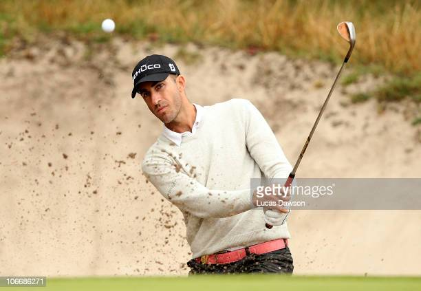 Geoff Ogilvy of Australia plays a shot out of the bunker during day one of the Australian Masters at The Victoria Golf Club on November 11 2010 in...