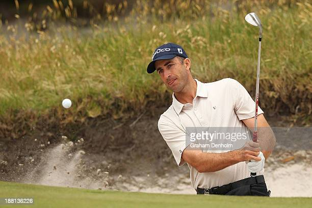 Geoff Ogilvy of Australia plays a shot out of the bunker during round three of the 2013 Australian Masters at Royal Melbourne Golf Course on November...