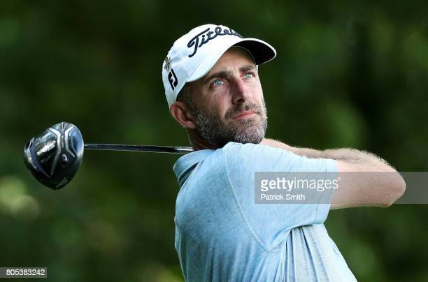 Geoff Ogilvy of Australia plays his shot from the eighth tee during the third round of the Quicken Loans National on July 1 2017 TPC Potomac in...