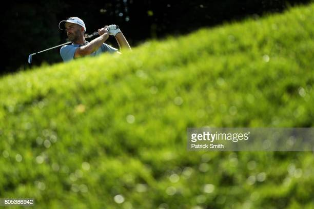 Geoff Ogilvy of Australia plays his shot from the ninth tee during the third round of the Quicken Loans National on July 1 2017 TPC Potomac in...