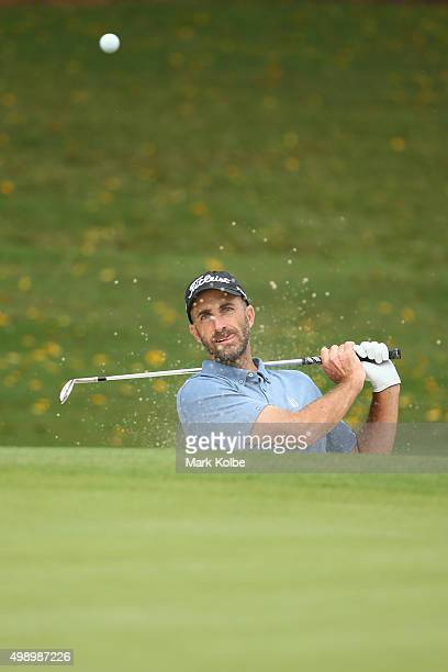 Geoff Ogilvy of Australia plays out of a bunker on the 5th hole during day three of the 2015 Australian Open at The Australian Golf Club on November...