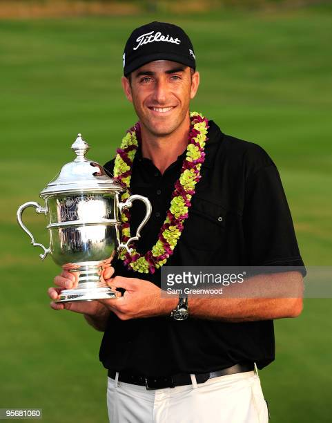 Geoff Ogilvy of Australia poses with the trophy after winning the SBS Championship at the Plantation course on January 10 2010 in Kapalua Maui Hawaii