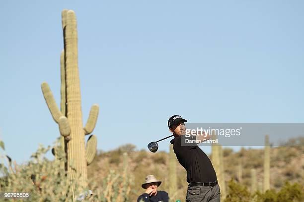 Geoff Ogilvy of Australia tees off on the seventh hole during round one of the Accenture Match Play Championship at the RitzCarlton Golf Club on...