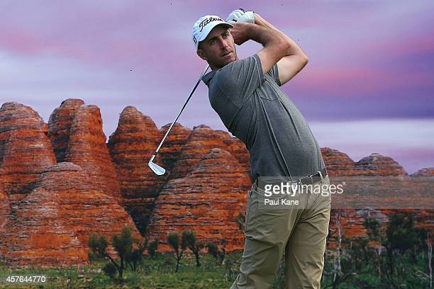 Geoff Ogilvy of Australia watches his tee shot on the 17th hole during the 2014 Perth International ProAm at Lake Karrinyup Country Club on October...