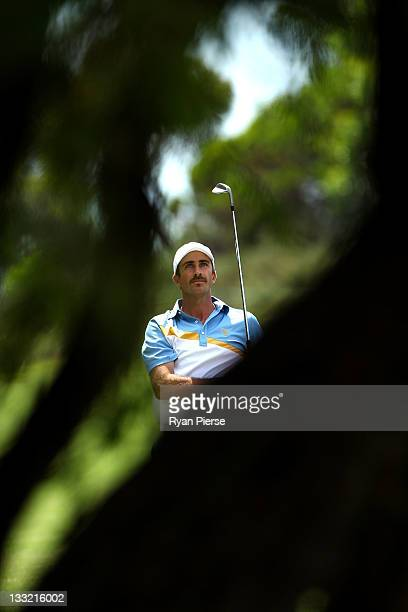 Geoff Ogilvy of the International Team watches his shot on the 13th hole during the Day Two FourBall Matches of the 2011 Presidents Cup at Royal...