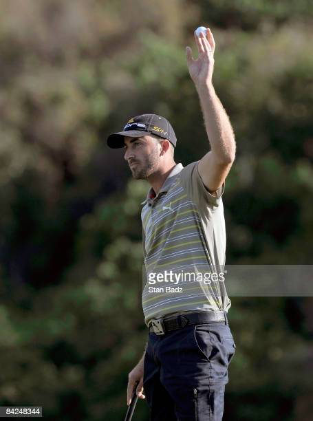 Geoff Ogilvy waves to the gallery at the 18th green after winning after the Mercedes-Benz Championship held at Plantation Course at Kapalua on...
