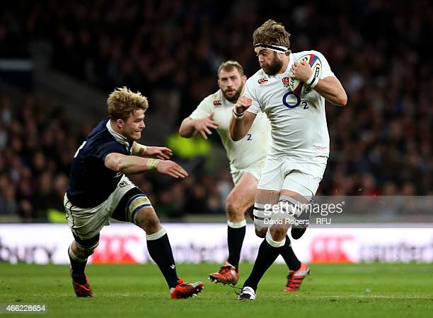 Geoff Parling of England is challenged by David Denton of Scotland during the RBS Six Nations match between England and Scotland at Twickenham...