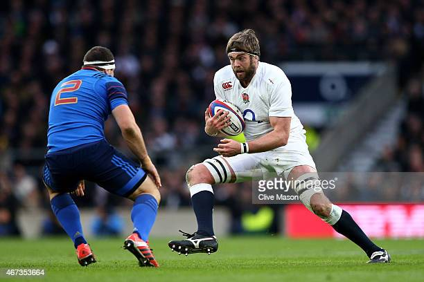 Geoff Parling of England is tackled by Guilhem Guirado of France during the RBS Six Nations match between England and France at Twickenham Stadium on...