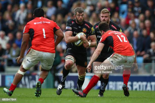 Geoff Parling of Exeter Chiefs charges towards Duncan Taylor of Saracens during the Aviva Premiership semi final match between Exeter Chiefs and...