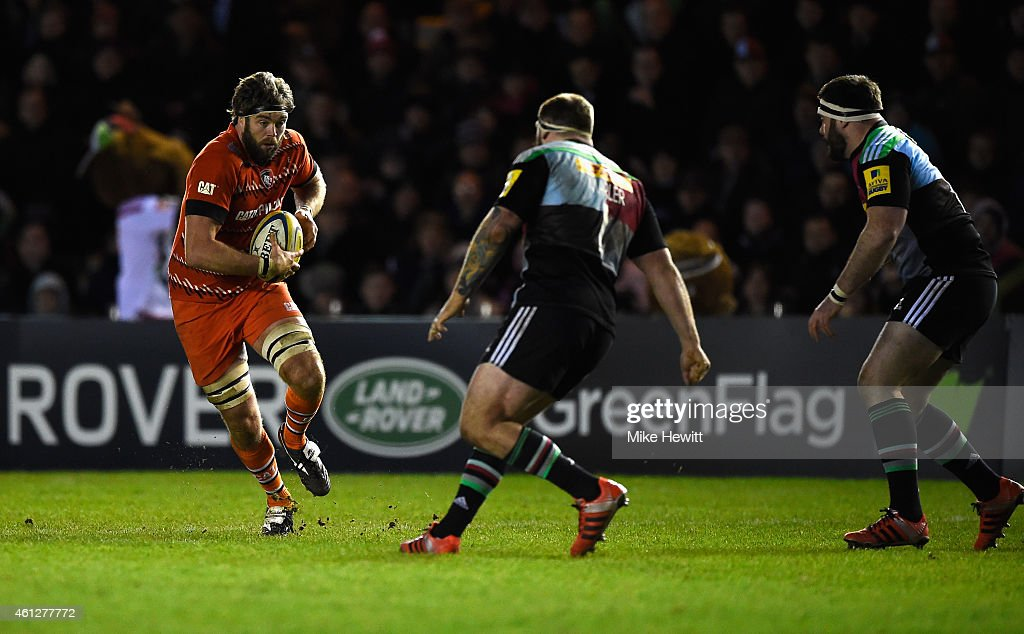 Geoff Parling of Leicester charges at Joe Marler of Harlequins during the Aviva Premiership match between harlequins and Leicester Tigers at Twickenham Stoop on January 10, 2015 in London, England.