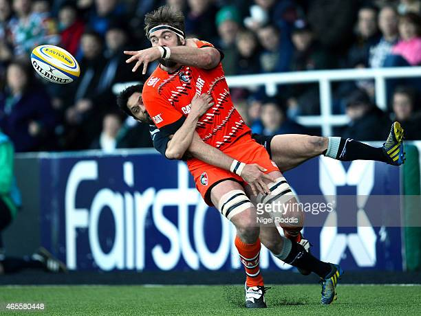 Geoff Parling of Leicester Tigers is challenged by Ruki Tipuna of Newcastle Falcons during the Aviva Premiership match between Newcastle Falcons and...