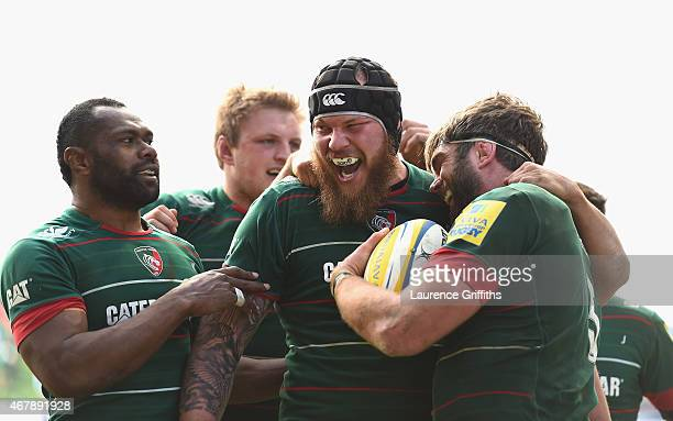 Geoff Parling of Leicester Tigers is congratulated by Sebastian de Chaves after scoring a second half try during the Aviva Premiership match between...