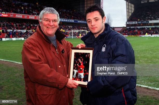 Geoff Peabody webmaster of The Official Nottingham Forest website presents a framed picture to Andy Reid after he was voted the websites Player of...