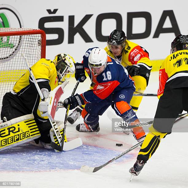 Geoff Platt of Vaxjo Lakers challenges Jussi Markkanen of SaiPa Lappeenranta during the Champions Hockey League Round of 16 match between Vaxjo...
