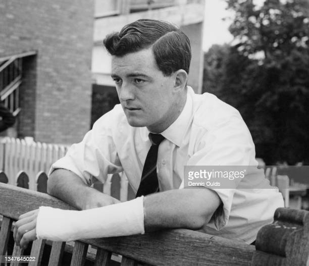 Geoff Pullar left handed opening batsman for Lancashire County Cricket Club and England looks on with his arm in a plaster cast after fracturing a...
