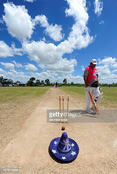 Geoff Ryder from the team 'Tuggers' walks past an Australian themed hat during the 2012 Goldfield Ashes cricket competition on January 22 2012 in...