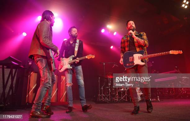 Geoff Sprung Brad Tursi and Matthew Ramsey of Old Dominion perform during a concert at Astra Kulturhaus on October 06 2019 in Berlin Germany